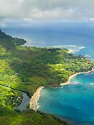 Aerial view of Haena and Wainiha Beach on the northern coast of Kauai, Hawaii on a cloudy day.