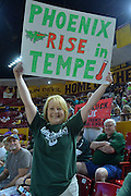 March 18, 2016; Tempe, Ariz;  A Green Bay Phoenix fan cheers during a game between No. 7 Tennessee Lady Volunteers and No. 10 Green Bay Phoenix in the first round of the 2016 NCAA Division I Women's Basketball Championship in Tempe, Ariz.