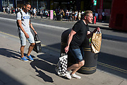 A swarm of bees disrupt worried shoppers on London's Oxford Street on the day that UK Prime Minster, Boris Johnson announced in parliament a major easing of Coronavirus pandemic restrictions on July 4th next week, including the re-opening of pubs, restaurants, hotels and hairdressers in England, on 23rd June 2020, in London, England. The three month two metre social distance will be also reduced to one metre plus but in the last 24hrs, a further 171 have died from Covid, bringing the UK total to 42,927.