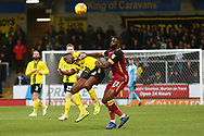 Burton Albion forward Lucas Akins (10) is challenged by Bradford City midfielder Hope Akpan (21) during the EFL Sky Bet League 1 match between Burton Albion and Bradford City at the Pirelli Stadium, Burton upon Trent, England on 26 January 2019.
