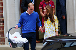 © Licensed to London News Pictures. 02/05/2015. LONDON, UK. Prince William, Duke of Cambridge and Catherine, Duchess of Cambridge departing The Lindo Wing with their newborn girl at St Mary's Hospital in London, England on May 2, 2015. The baby, as yet unnamed, is forth in line to the throne. Photo credit : Tolga Akmen/LNP