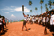 SRI LANKA, PEOPLE, EDUCATION Children playing cricket outdoors at rural school near Bentota