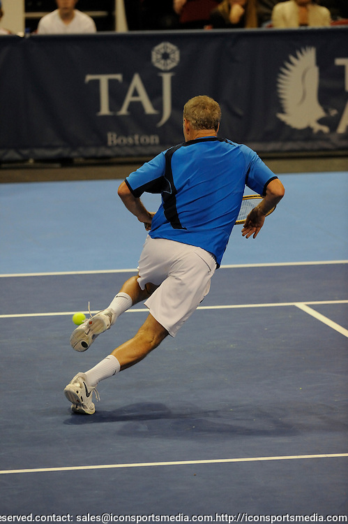 04 May 2008: John McEnroe scrambles to successfully return a passing shot from Aaron Krickstein during the first set of the Champions Cup Boston final. McEnroe wins the title after loosing the first set  5-7, 6-3, 10-5 (Champions Tie Break) in the championship match at the Agganis Arena, Boston, MA.