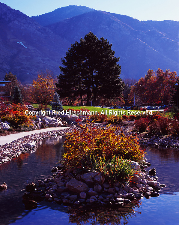 Pond on the campus of Brigham Young University with Y Mountain beyond, Provo, Utah.