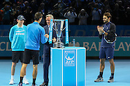 Novak Djokovic goes up to collect his winning trophy during the final of the ATP World Tour Finals between Roger Federer of Switzerland and Novak Djokovic at the O2 Arena, London, United Kingdom on 22 November 2015. Photo by Phil Duncan.