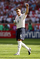 Photo: Chris Ratcliffe.<br /> England v Paraguay. Group B, FIFA World Cup 2006. 10/06/2006.<br /> John Terry of England thanks  the fans at the end.