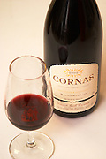 A bottle of Cornas 2002 and a glass against a white background. Domaine Eric et Joel Joël Durand, Ardeche, Ardèche, France, Europe