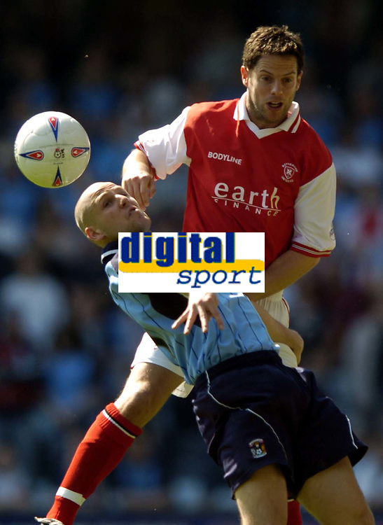 Photo: Richard Lane.<br />Coventry City v Rotherham United. Nationwide Division One. 24/04/2004.<br />Graham Barrett is challenged by Richard Barker.