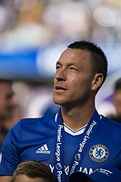 Football - 2016 / 2017 Premier League - Chelsea vs. Sunderland <br /> <br /> John Terry of Chelsea watches a montage of his Chelsea career on the stadium screen at Stamford Bridge.<br /> <br /> COLORSPORT/DANIEL BEARHAM
