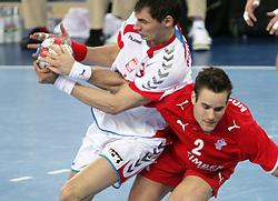 Krzysztof Lijewski (3) of Poland vs Thomas T. Mogensen of Denmark  during 21st Men's World Handball Championship 2009 Bronze medal match between National teams of Poland and Denmark, on February 1, 2009, in Arena Zagreb, Zagreb, Croatia.  Won of Poland 31:23. (Photo by Vid Ponikvar / Sportida)