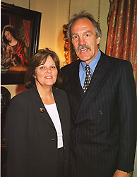 MR & MRS ROGER UTTLEY he is the leading figure in English rugby, at a party in London on 18th May 1999.MSE 3
