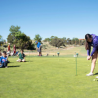 Mariana Chamberlin teaches Elijah Gay, 5, how to putt during the Gallup Junior Golf Clinic, Wednesday, June 12 at Fox Run Golf Course in Gallup.