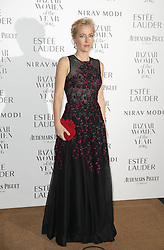 Gillian Anderson arrives at Claridge's Hotel in London to attend the Harper's Bazaar Women of the Year Awards.