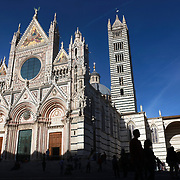 SIENA, ITALY - OCTOBER 26:  Siena Cathedral, a<br /> Romanesque-Gothic cathedral with mosaics. It's 13th-century structure is famed for its facade and its marble stripes in symbolic black and white. Siena, Italy. 26th October 2017. Photo by Tim Clayton/Corbis via Getty Images)