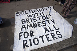 © Licensed to London News Pictures. 29/03/2021. London, UK. A sign laid on the floor near the former Cavendish Road Police Station in Clapham in south London where squatters occupied the building as part of a 'Kill The Bill' protest. Murdered woman Sarah Everard walked past the building on the night she went missing on March 3, 2021. Photo credit: Ben Cawthra/LNP