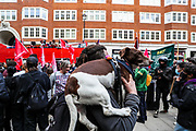 """A man brought his dog to participate at a """"Kill the Bill"""" demonstration outside Home Office in central London on Saturday, May 1st, 2021. (Photo/ Vudi Xhymshiti)"""