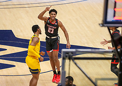 Jan 25, 2021; Morgantown, West Virginia, USA; Texas Tech Red Raiders guard Chibuzo Agbo (23) celebrates after a made three pointer during the first half against the West Virginia Mountaineers at WVU Coliseum. Mandatory Credit: Ben Queen-USA TODAY Sports