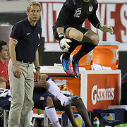 USA National Mens Team head coach Jurgen Klinsmann and United States Goalkeeper Brad Guzan (12)  during an international friendly soccer match between Scotland and the United States at EverBank Field on Saturday, May 26, 2012 in Jacksonville, Florida.  The United States won the match 5-1 in front of 44,000 fans. (AP Photo/Alex Menendez)