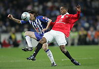 """PORTUGAL - PORTO 28 FEBRUARY 2005: """"MANICHE"""" Nuno Ricardo Oliveira Ribeiro #18 (L) and LUIS MIGUEL #23 (R) compete for the ball, in the 23 leg of the Portuguese soccer league """"Super Liga"""" FC Porto (1) vs SL Benfica (1), held in """"Dragao"""" stadium  28/02/2005  19:51:16<br />(PHOTO BY: NUNO ALEGRIA/AFCD)<br /><br />PORTUGAL OUT, PARTNER COUNTRY ONLY, ARCHIVE OUT, EDITORIAL USE ONLY, CREDIT LINE IS MANDATORY AFCD-PHOTO AGENCY 2004 © ALL RIGHTS RESERVED"""