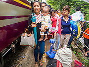16 JUNE 2014 - ARANYAPRATHET, THAILAND:  Cambodian migrants crowd the platform of the train station at the end of the train line in Aranyaprathet, Thailand. More than 150,000 Cambodian migrant workers and their families have left Thailand since June 12. The exodus started when rumors circulated in the Cambodian migrant community that the Thai junta was going to crack down on undocumented workers. About 40,000 Cambodians were expected to return to Cambodia today. The mass exodus has stressed resources on both sides of the Thai/Cambodian border. The Cambodian town of Poipet has been over run with returning migrants. On the Thai side, in Aranyaprathet, the bus and train station has been flooded with Cambodians taking all of their possessions back to Cambodia. PHOTO BY JACK KURTZ