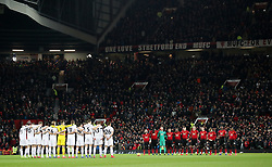 """Players observe a minute's silence in honour of the Munich Air disaster during the Premier League match at Old Trafford, Manchester. PRESS ASSOCIATION Photo. Picture date: Tuesday January 29, 2019. See PA story SOCCER Man Utd. Photo credit should read: Martin Rickett/PA Wire. RESTRICTIONS: EDITORIAL USE ONLY No use with unauthorised audio, video, data, fixture lists, club/league logos or """"live"""" services. Online in-match use limited to 120 images, no video emulation. No use in betting, games or single club/league/player publications"""