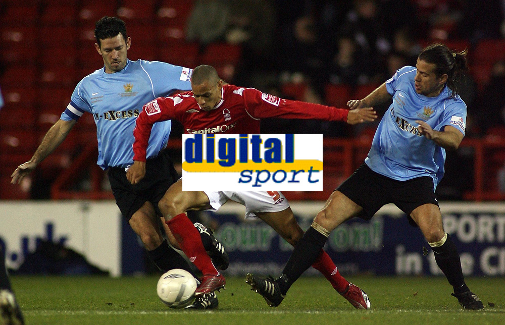 Photo: Paul Thomas.<br /> Nottingham Forest v Salisbury. The FA Cup. 12/12/2006.<br /> <br /> Nathan Tyson of Forest (C) pushes through Paul Sales (R) and Aaron Cook.