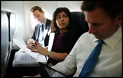 Sayeeda Warsi going through her speech on the flight to Rome with Secretary of Culture and Sport Jeremy Hunt (right) and Greg Barker, where she will deliver a speech to Pontifical ecclesiastical academy, Tuesday February 14, 2012. Photo by Andrew Parsons/ I-images.BYLINE MUST READ ANDREW PARSONS/i-Images