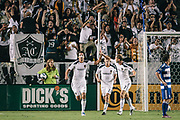 Los Angeles Galaxy defender Omar Gonzalez, left, celebrates scoring with teammate Gregg Berhalter during the first half of an MLS soccer match, Saturday, Aug. 6, 2011, in Carson, Calif. (AP Photo/Bret Hartman)