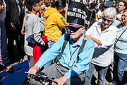 20 September 2019 - New York, NY.  Thousands of students as well as adults gathered in New York for the Global Climate Strike, meeting in Foley Square near the Federal Government buildings and New York's City Hall, and marching downtown to Battery Park, where Swedish climate activist and spokesperson Greta Thunberg addressed the crowd. An elderly man in a wheelchair joins the march.