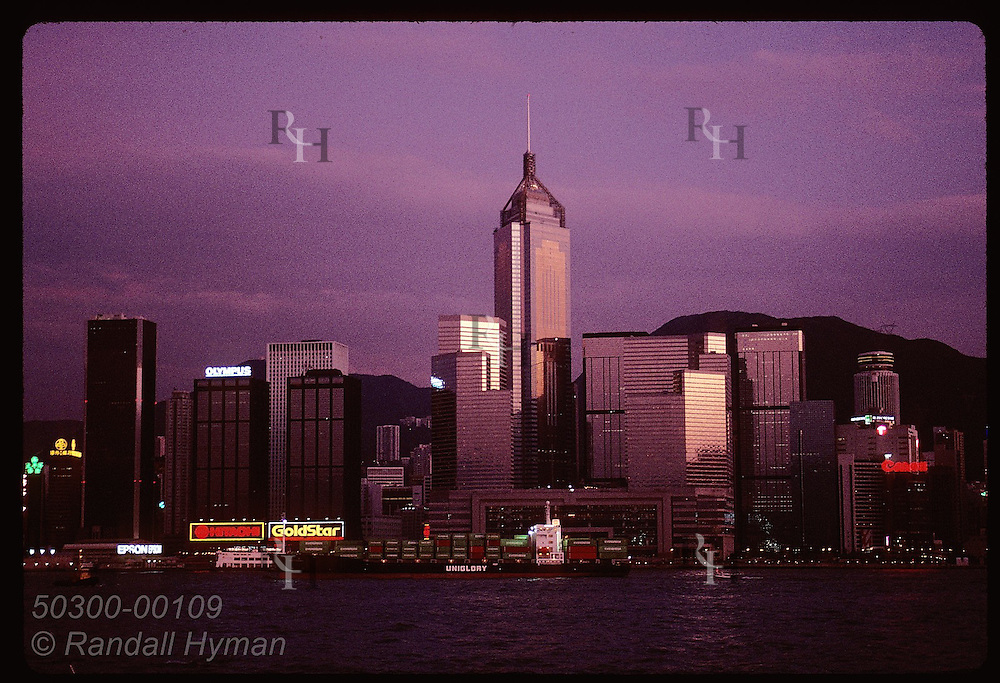 Central Plaza, 4th tallest bldg in world, catches sun's last glow in Kowloon view of Hong Kong. Hong Kong