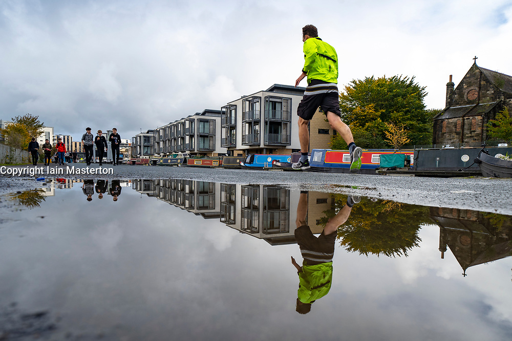 Edinburgh, Scotland, UK. 5 October, 2020. After a weekend of heavy rain from Storm Alex , members of the public were out on the towpath of the Union Canal at Fountainbridge today enjoying some dry, calm weather. Pictured; People exercising beside the Union Canal.  Iain Masterton/Alamy Live News