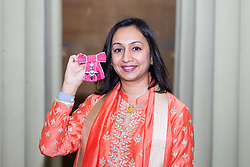 Roma Agrawal, Associate Director, AECOM displays her MBE For services to Engineering following her investiture by Prince William at Buckingham Palace in London. London, December 07 2018.