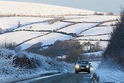 © Licensed to London News Pictures. 14/01/2015. Wheddon Cross, Devon, UK. A Range Rover 4x4 driving on snowy roads near Wheddon Cross near Exmoor National Park in Devon this morning, 14th January 2015. Snow has fallen overnight across many parts of England, causing travel disruption in some areas.  Photo credit : Rob Arnold/LNP