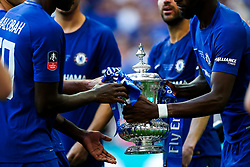 Trevoh Chalobah and Tiemoue Bakayoko of Chelsea get their hands on the FA Cup after Chelsea win 1-0 to win the FA Cup - Rogan/JMP - 19/05/2018 - FOOTBALL - Wembley Stadium - London, England - Chelsea v Manchester United - FA Cup Final.