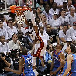 Jun 21, 2012; Miami, FL, USA; Miami Heat shooting guard Dwyane Wade (3) dunks over Oklahoma City Thunder small forward Kevin Durant (35) during the fourth quarter in game five in the 2012 NBA Finals at the American Airlines Arena. Mandatory Credit: Derick E. Hingle-US PRESSWIRE
