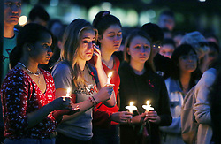 UCF student Emily Molen, with a hand to her face, shares a somber moment during a candlelight vigil at Memory Mall on the UCF campus in Orlando, FL, USA, in commemoration of the one-year anniversary of the mass shooting at Marjory Stoneman Douglas High School, on Thursday, February 14, 2019. Photo by Stephen M. Dowell/Orlando Sentinel/TNS/ABACAPRESS.COM