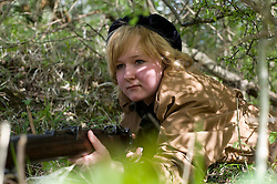 Female reenactor from Northern World War Two Association, portraying the French Resistance waits to ambush German troops during a private 24hr excerise.<br /> Sutton Grange, near Ripon Yorkshire 15  May 2010 .Images © Paul David Drabble.