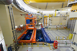RWE employees work next to a pool of water containing spent nuclear fuel rods, in the nuclear reactor chamber, at the RWE nuclear power plant, in Lingen, Germany, on Tuesday, Sept. 6, 2011. (Photo © Jock Fistick)