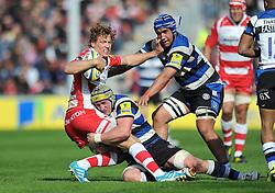 Billy Twelvetrees (Gloucester) is tackled by Carl Fearns (Bath) - Photo mandatory by-line: Patrick Khachfe/JMP - Tel: Mobile: 07966 386802 12/04/2014 - SPORT - RUGBY UNION - Kingsholm Stadium, Gloucester - Gloucester Rugby v Bath Rugby - Aviva Premiership.