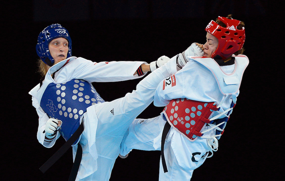 Canada's Karine Sergerie gets kicked in the face as she fights Franka Anic of Slovenia in the women's 67kg taekwondo quaterfinals during the 2012 Summer Olympics in London on Friday, August 10, 2012. Canada lost the fight. THE CANADIAN PRESS/Sean Kilpatrick