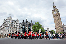 © Licensed to London News Pictures. 19/06/2012. LONDON, UK. Members of the British Army's 20 Armoured Brigade are led by guards bandsmen as they parade through Westminster as they march to the Houses of Parliament for a reception with MPs following their return from Afghanistan. Photo credit: Matt Cetti-Roberts/LNP