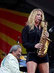27 April 2013. New Orleans, Louisiana,  USA. .New Orleans Jazz and Heritage Festival. Allen Toussaint invites saxophonist and singer Grace Darling to the Acura stage..Photo; Charlie Varley.
