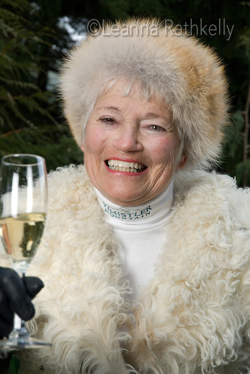 Portraits of renowned Whistler artist Izzy MacLaurin show her zest for life as she enjoys champagne while sitting in her hand-painted coffin.