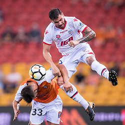 BRISBANE, AUSTRALIA - OCTOBER 13: Petros Skapetis of the Roar is fouled by Ersan Gulum of Adelaide during the Round 2 Hyundai A-League match between Brisbane Roar and Adelaide United on October 13, 2017 in Brisbane, Australia. (Photo by Patrick Kearney)