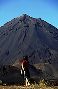 One tourist looks at Fogo island's volcano. This had its most recent eruption in 1995. Inside the massive caldera a little dispersed village survives due to the rich volcanic soil and its inhabitants grow vineyards and fruit trees.