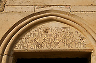 Close up picture & image of a Georgian inscription on the main entrance to David Gareja Georgian Orthodox monastery, Mount Gareja, Kakheti Region, Georgia (country)<br /> <br /> Founded in the 6th century by David (St. David Garejeli), one of the  thirteen Assyrian monks who built monasteries throughout Georgia. The monastery is spread out over a huge area of the arid Mount Gareja, with small cells and chapels cut into cliff faces. .<br /> <br /> Visit our MEDIEVAL PHOTO COLLECTIONS for more   photos  to download or buy as prints https://funkystock.photoshelter.com/gallery-collection/Medieval-Middle-Ages-Historic-Places-Arcaeological-Sites-Pictures-Images-of/C0000B5ZA54_WD0s<br /> <br /> Visit our REPUBLIC of GEORGIA HISTORIC PLACES PHOTO COLLECTIONS for more photos to browse, download or buy as wall art prints https://funkystock.photoshelter.com/gallery-collection/Pictures-Images-of-Georgia-Country-Historic-Landmark-Places-Museum-Antiquities/C0000c1oD9eVkh9c