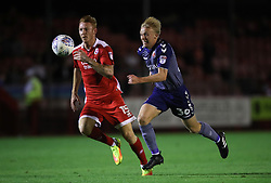 Crawley Town's Josh Yorweth and Charlton Athletic's George Lapsie battle for the ball