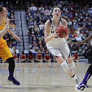 Katie Lou Samuelson, (right), UConn, drives past Marina Laramie, East Carolina, during the UConn Huskies Vs East Carolina Pirates Quarter Final match at the  2016 American Athletic Conference Championships. Mohegan Sun Arena, Uncasville, Connecticut, USA. 5th March 2016. Photo Tim Clayton