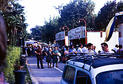 People walking past food shop stalls, Bardolino, Veneto, Italy 1975