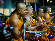 "01 MARCH 2018 - BANGKOK, THAILAND:    Buddhist monks lead a merit making ceremony at Wat Pathum Wanaram in central Bangkok. Many people go to temples to perform merit-making activities on Makha Bucha Day, which marks four important events in Buddhism: 1,250 disciples came to see the Buddha without being summoned, all of them were Arhantas, or Enlightened Ones, and all were ordained by the Buddha himself. The Buddha gave those Arhantas the principles of Buddhism. In Thailand, this teaching has been dubbed the ""Heart of Buddhism.""    PHOTO BY JACK KURTZ"